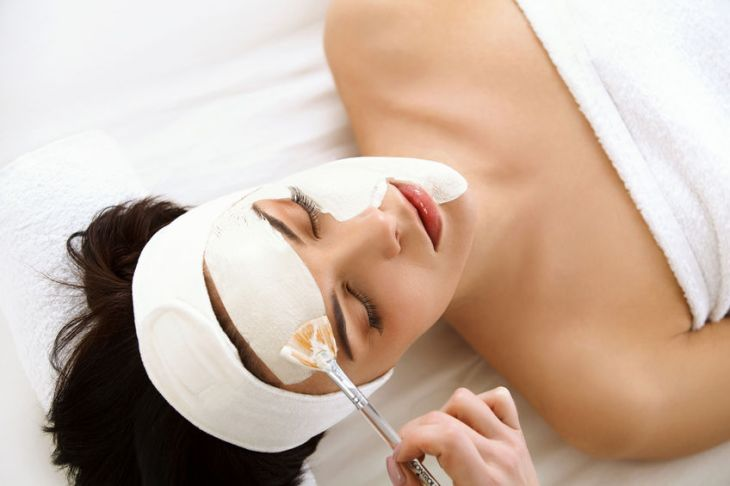 39623113 - spa mask. woman in spa salon. face mask. facial clay mask. treatment